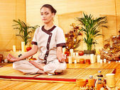 Bamboo massage at spa and woman. — Zdjęcie stockowe