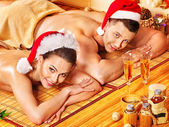 Man and woman relaxing in Xmas spa. — Stock Photo