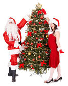 Christmas girl, santa clause and fir tree. — Stock Photo