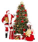 Girl and Santa clause by Christmas tree. — Stock Photo