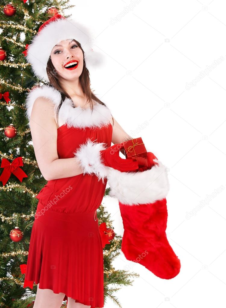 Girl in Santa hat holding christmas socks and gift box by christmas tree.  Isolated.  Stock Photo #14160029
