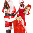 Foto Stock: Christmas shopping of girl and santa clause with tree.