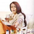 Woman having pills and tablets. - Stok fotoğraf