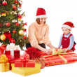 Children with gift box near Christmas tree. — Stock Photo #14621203