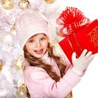 Child in hat and mittens holding red gift box . — Stock Photo #14621215