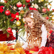 Child with gift box near Christmas tree. — Stock Photo #14621219