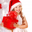 Child in Santa hat with gift box near white Christmas tree. — Stock Photo #14621229