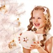 Stock Photo: Child decorate white Christmas tree.