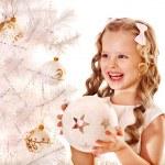 Child decorate white Christmas tree. — Stock Photo #14621297