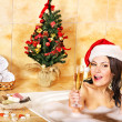 Royalty-Free Stock Photo: Woman in santa hat relax in bath.