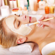 Clay facial mask in beauty spa. — Stock Photo #14621331