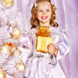 Child decorate white Christmas tree. - Stock Photo