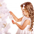 Child holding snowflake to decorate Christmas tree . - Stock Photo