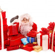 Santa Clause holding gift. - Photo