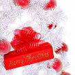 Stock Photo: White Christmas tree and red gift box.