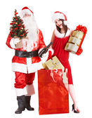 Christmas shopping of girl and santa clause with tree. — Stock Photo