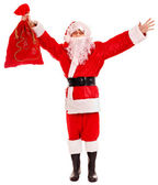 Santa Clause holding gift. — Stock Photo