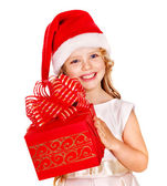 Child in Santa hat with gift box. — Stock Photo