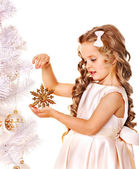Child holding snowflake to decorate Christmas tree . — Stock Photo
