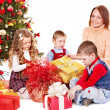 Children with gift box near Christmas tree. — Stock Photo