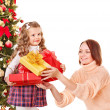 Family with children open gift box near Christmas tree. — Stock Photo