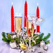 Stock Photo: Christmas still life with champagne and candle.