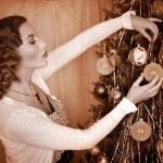 Woman dressing Christmas tree. — Stock Photo #14917565