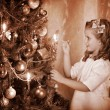 Royalty-Free Stock Photo: Child ignites candles on Christmas tree.