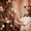 Child ignites candles on Christmas tree. — Stock Photo