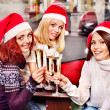 Women in santa hat drinking champagne. — Stock Photo #14918463