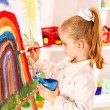 Child drawing on the easel. — Stok fotoğraf