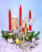 Christmas still life with champagne and candle. — Stok fotoğraf