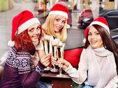Women in santa hat drinking champagne. — Stock Photo