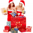 Girl in Santa hat holding Christmas gift box. — Stock Photo #14921339