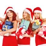 Girl in Santa hat holding Christmas gift box. — Stock Photo #14921575