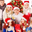 Stock Photo: Group and Christmas tree.