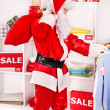 Santa Claus in clothing store. — Stock Photo