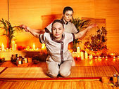 Therapist giving stretching massage to woman. — Stock Photo
