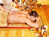 Woman getting bamboo massage. — Stock Photo