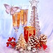 Christmas still life with champagne and candle. ation. - Stock Photo