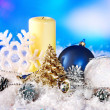 Christmas still life with snowflake and candle. — Stock Photo #16048753