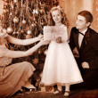 Family with children  dressing Christmas tree. - Stock Photo