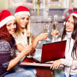 Women in santa hat drinking champagne. — Stock Photo #16049753