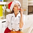 Female chef in Santa hat holding food. — Stock Photo #16049757