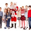 Group of children with Santa Claus. — Stock Photo #16050257