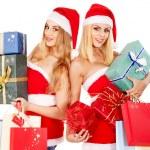 Girl in Santa hat holding Christmas gift box. — Stock Photo #16052103