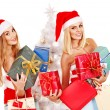 Girl in Santa hat holding Christmas gift box. - Stock Photo