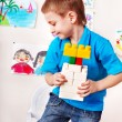 Child playing construction set. — Stock Photo