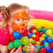 Little girl play colourful balls. — Stock Photo