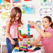 Child playing construction set with mother. — Stock Photo #16054293